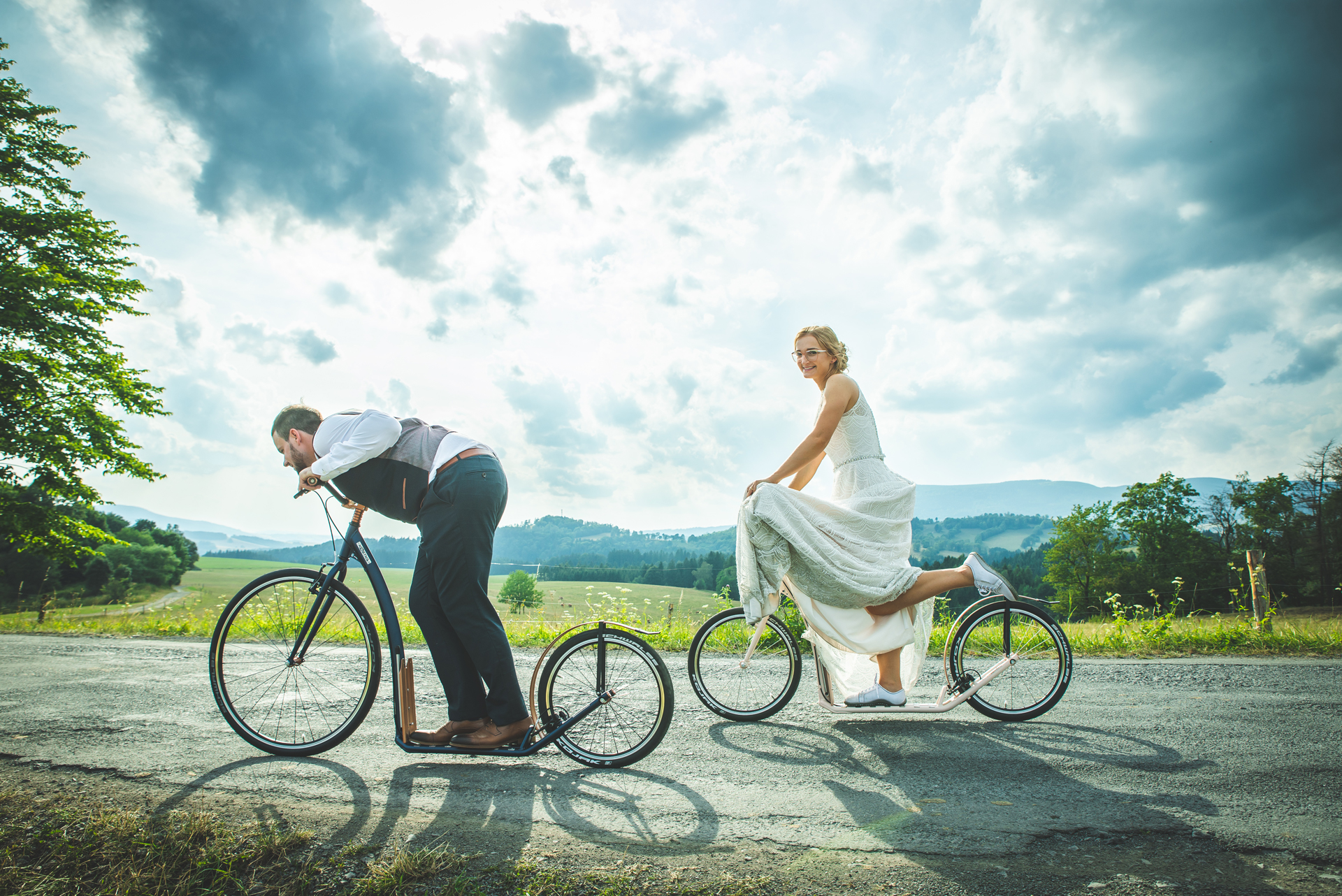 Newlyweds Mr. and Mrs. Kostka on their footbikes
